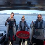 3 people on fishing Charter with thier catch