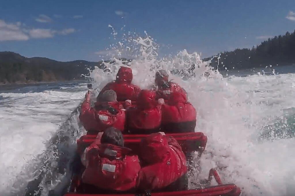 Zodiac crashing through Wave on Rapids Tour