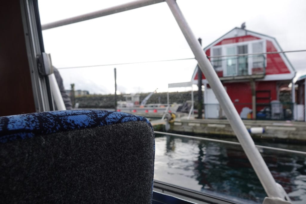 Red Float House seen through window of whale watching boat
